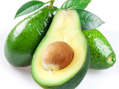 Ripe avacados with leaves on a white background.